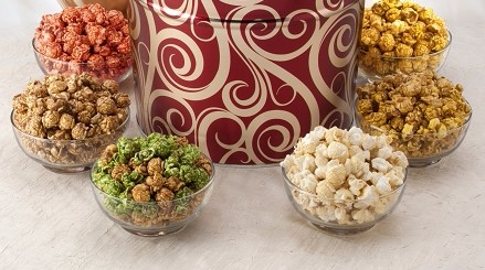 6 Tropical Popcorn flavors packaged  in a decorative tin
