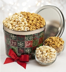 Holiday tin filled with Sea Salt Kettle popcorn and Carmel popcorn